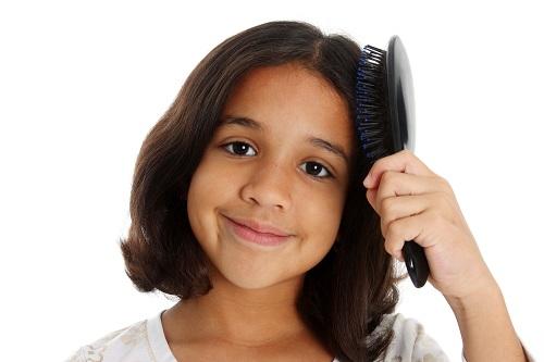 Child brushing hair tips