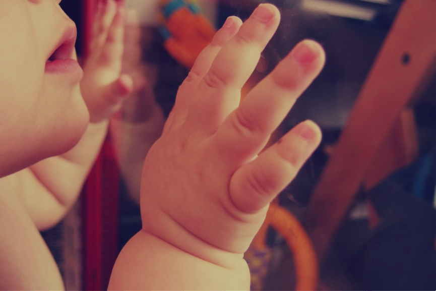 baby hand on the window