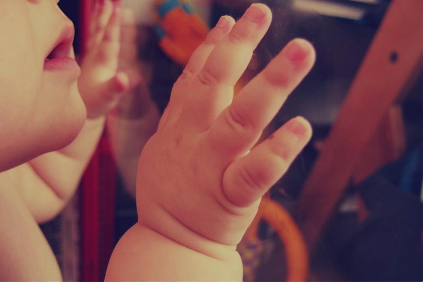 baby hand on the window