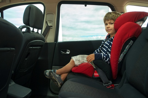 Toddler in booster seat