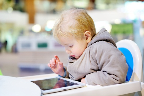 Toddler on tablet