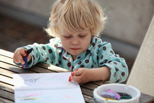 Leftie child drawing a picture