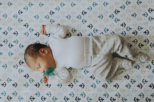 Peaceful baby sleeping in a crib